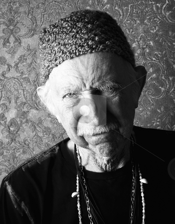 Aging Tough Guy stock photo, Senior tough guy in green knit cap leaning by Scott Griessel