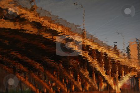 Bridge stock photo, Reflection of the bridge in the water in the sunset light by Leyla Akhundova