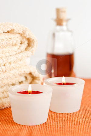 Candles, Massage Oil, Towels stock photo, A set of burning red candles, massage oil and towels by Alexander Zschach