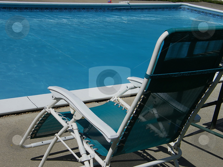 Outdoor Lounge Chair stock photo, Outdoor Lounge Chair beside a crystal clear in-ground pool. by Dazz Lee Photography