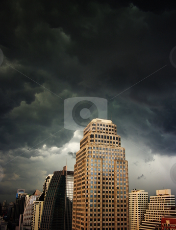 Thunderstorm clouds stock photo, A dark and menacing sky over highrise buildings. Bangkok, Thailand by Martin Darley