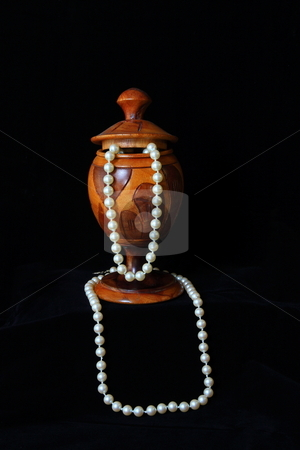 Pearl Display stock photo, Wooden gobblet pearl display on black velvet background by Jack Schiffer