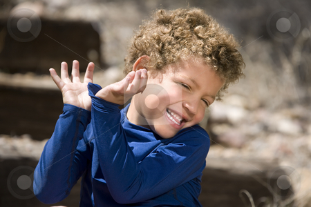 Cute young boy stock photo, Portrait of cute boy with curly hair laughing outdoors by Scott Griessel