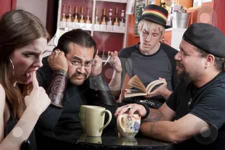 Bad Poetry stock photo, Three friends listening to bad male poet with smoky cigarette in a coffee house by Scott Griessel