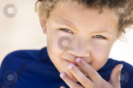 Cute young boy stock photo, Portrait of cute boy with curly hair outdoors by Scott Griessel