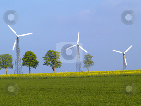 Three wind power plants stock photo, Three wind power plants on nice spring day by Torsten Lorenz
