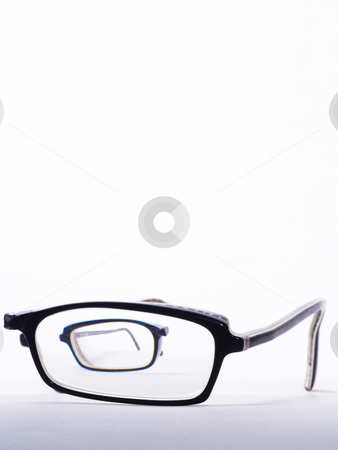 Broken eyeglasses stock photo, Broken eyeglasses one half to be seen throug glass of the other half by Torsten Lorenz