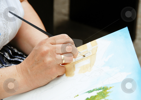 Artist painting hand stock photo, Woman artist hand painting picture on canvas by Julija Sapic