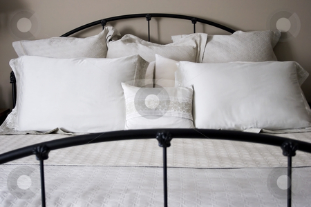 Elegant Bed stock photo, A rod iron bed made up with elegant sheets by Matt Baker