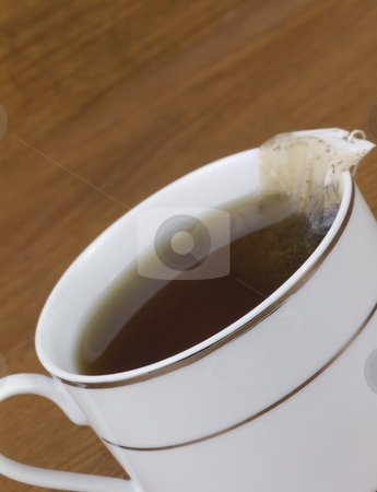 Close up cup of tea stock photo, Close up cup fo tea on a wooden background by John Teeter