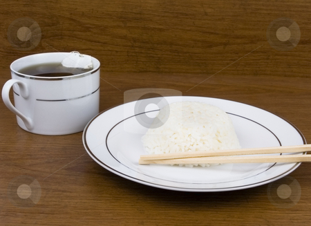 Rice and Tea stock photo, Rice bowl and tea on a wooden background by John Teeter