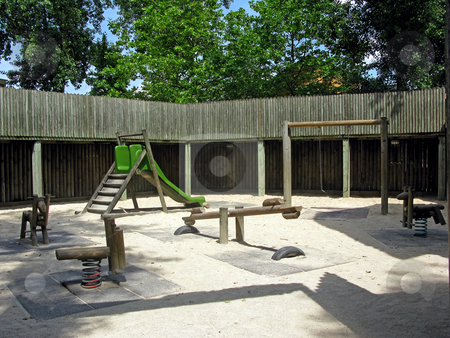Playground in the Woods stock photo, A playground in the middle of a forest, in a fort with sand on the ground. by Lucy Clark