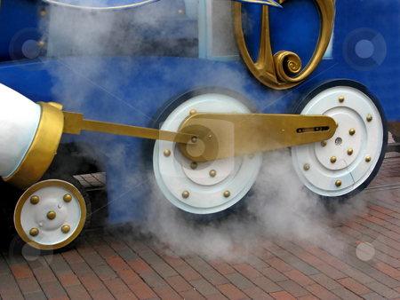 Train Wheels stock photo, Train wheels with steam coming off of them. by Lucy Clark