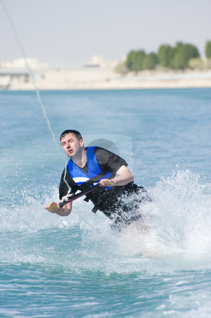 Wakeboarder in action stock photo, A wakeboarder falling while riding the wakeboard. by Nicolaas Traut