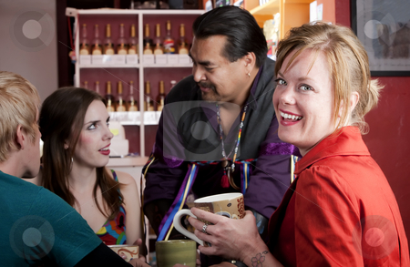 Coffee House Friends stock photo, Four friends having an animated discussion in a coffee house by Scott Griessel