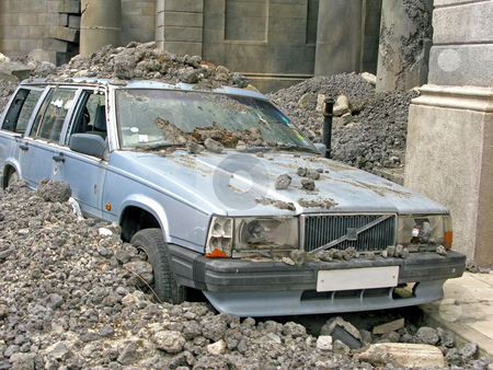 Car Crash stock photo, A car in amongst a lot of concrete rubble. by Lucy Clark