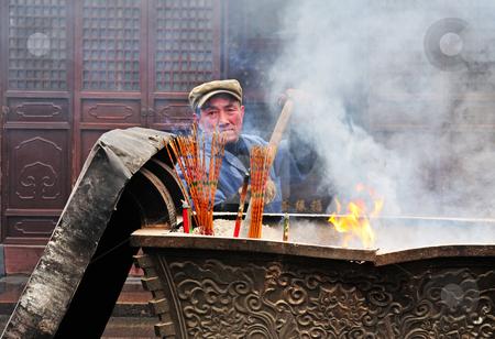 Chinese buddhist shrine  stock photo, Worker in Chinese buddhist shrine in the city of Shanghai China by Kobby Dagan