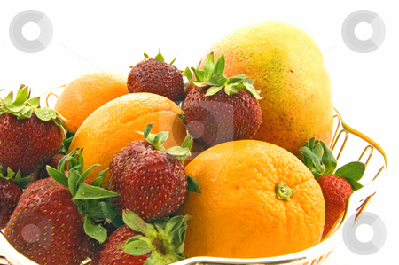 Still Life of Mango, Strawberries and Oranges stock photo, This still life is a silver dish of a mango, strawberries and oranges in a beautiful closeup photo of luscious fruit. by Valerie Garner