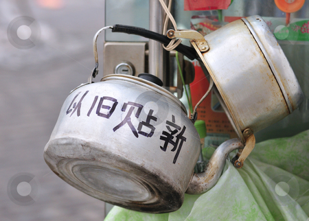 Kettle stock photo, Old kettle in Chinese street by Kobby Dagan