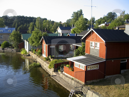 Red houses on the river stock photo, Red houses on the river in Porvoo, Finland by Alessandro Rizzolli