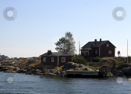 Red wooden houses stock photo, Two red wooden houses on a rock island near Helsinki, FInland by Alessandro Rizzolli