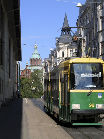 Helsinki tram stock photo, Green and yellow tram in the streets of Helsinki with Uspensky cathedral in the background by Alessandro Rizzolli