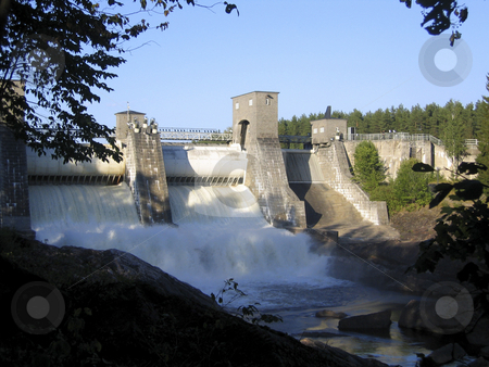 Floodgates open stock photo, Shot of Imatrankoski dam in Imatra, FInland, while the gates are opening and the water starts to flow by Alessandro Rizzolli