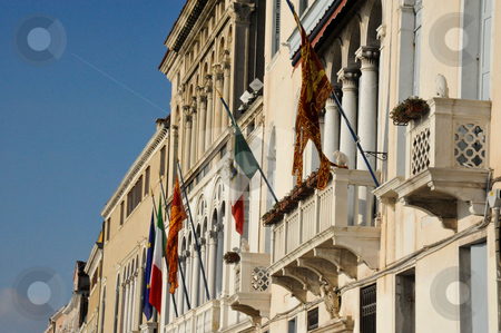 Building and flags  stock photo, Building and flags in Venice by Jaime Pharr