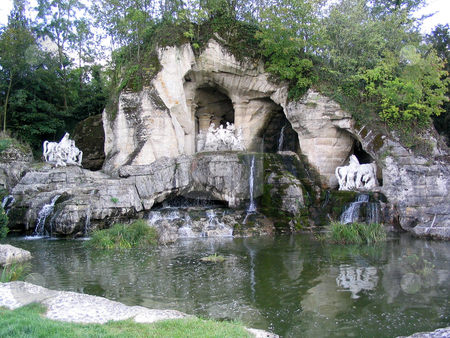 Versailles grotto stock photo, Grotto and statues in Versailles garden by Jaime Pharr