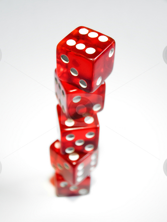 Risk growth stock photo, Conceptual image with several dice on a clear background represent growth of risk in investment. by Sinisa Botas