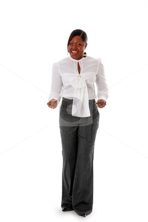 African business woman snapping fingers stock photo, Beautiful African American business woman dressed in a white shirt and gray pants standing, snapping fingers, isolated by Paul Hakimata