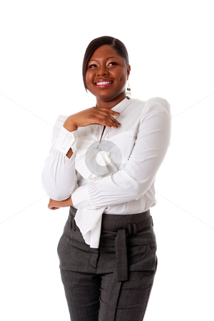 African business woman laughing stock photo, Beautiful African American business woman with attitude dressed in a white shirt and gray pants standing, laughing, isolated by Paul Hakimata