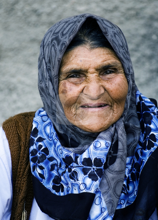 Old woman stock photo, Old Turkish woman in the street of Ankara by Kobby Dagan