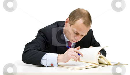 Studying businessman stock photo, A businessman sweating over technical literature, expanding his knowledge through further studies by Corepics VOF
