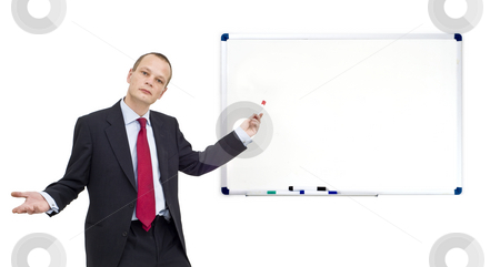 Whiteboard presentation stock photo, A businessman, pointing with a red marker towards a whiteboard - waiting for your message, just paste it in - plenty of copyspace available! by Corepics VOF