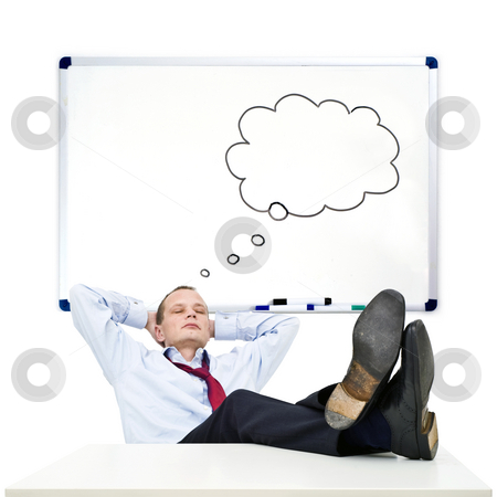 Lost in thoughts stock photo, A business man, with his nectie loosened, his collar unbuttoned, resting with his feet on a table is lost in thought by Corepics VOF