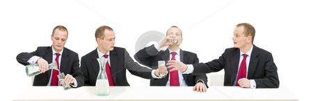 Drinking water stock photo, A businessman helping himself to a glass of water by Corepics VOF