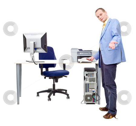 Printing is easy stock photo, A man demonstrating how easy it is to print professional documents by taking a sheet of paper out of a printer in an office by Corepics VOF