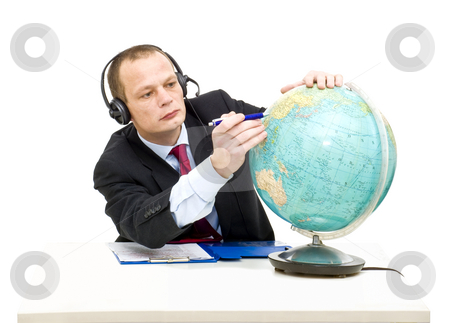 Exploring international markets stock photo, A businessman with a headset on, pointing his pen at China on a globe. A conceptual image for exploring international markets by Corepics VOF