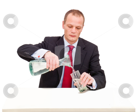 Getting water stock photo, A businessman pouring a glass of water behind a desk by Corepics VOF