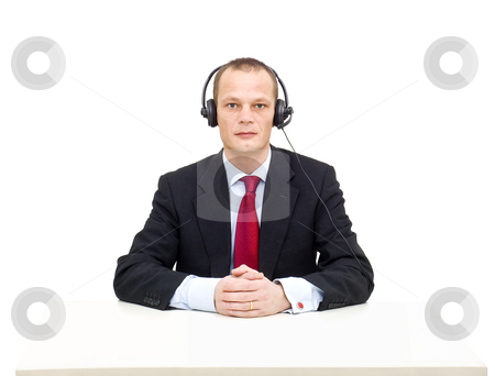 Business service stock photo, A businessman with a headset and microphone ready to take your call by Corepics VOF