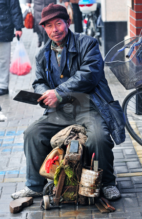 Chinese worker stock photo, Chinese worker in Shanghai street by Kobby Dagan