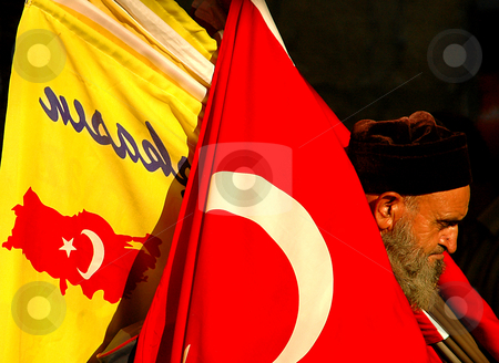 Flag seller stock photo, Old Turkish man selling flags by Kobby Dagan