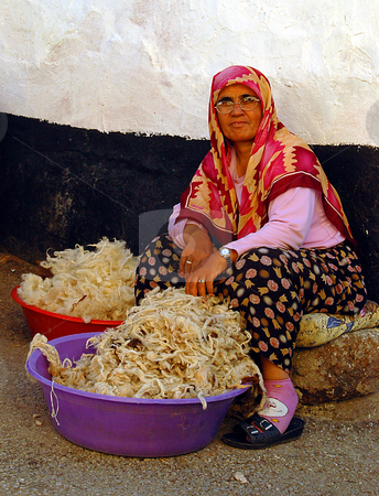 Turkish woman stock photo, Turkish woman working with wool in Ankara street by Kobby Dagan