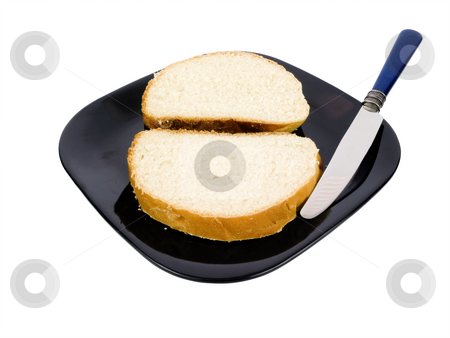 Sliced Bread stock photo, Sliced bread on a black plate with knife by John Teeter