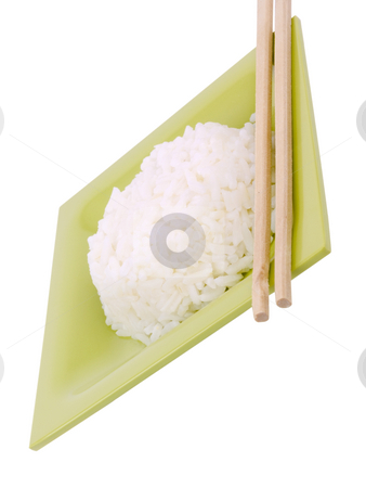 Rice on white background stock photo, Rice with chop sticks on a white background by John Teeter
