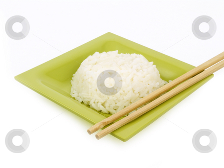 Rice with Chop Sticks stock photo, Rice with chop sticks on a white background by John Teeter