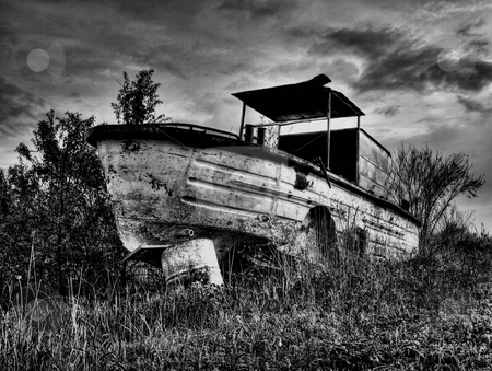 Old river boat stock photo, Old,rusty and abandoned river boat  in bw technique. by Sinisa Botas