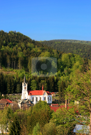 Mountain Church stock photo, A little church in a mountain village in spring by Petr Koudelka