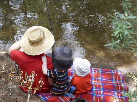 Father and Sons fishing stock photo, Father and two young sons share a moment fishing by Gary Cookson